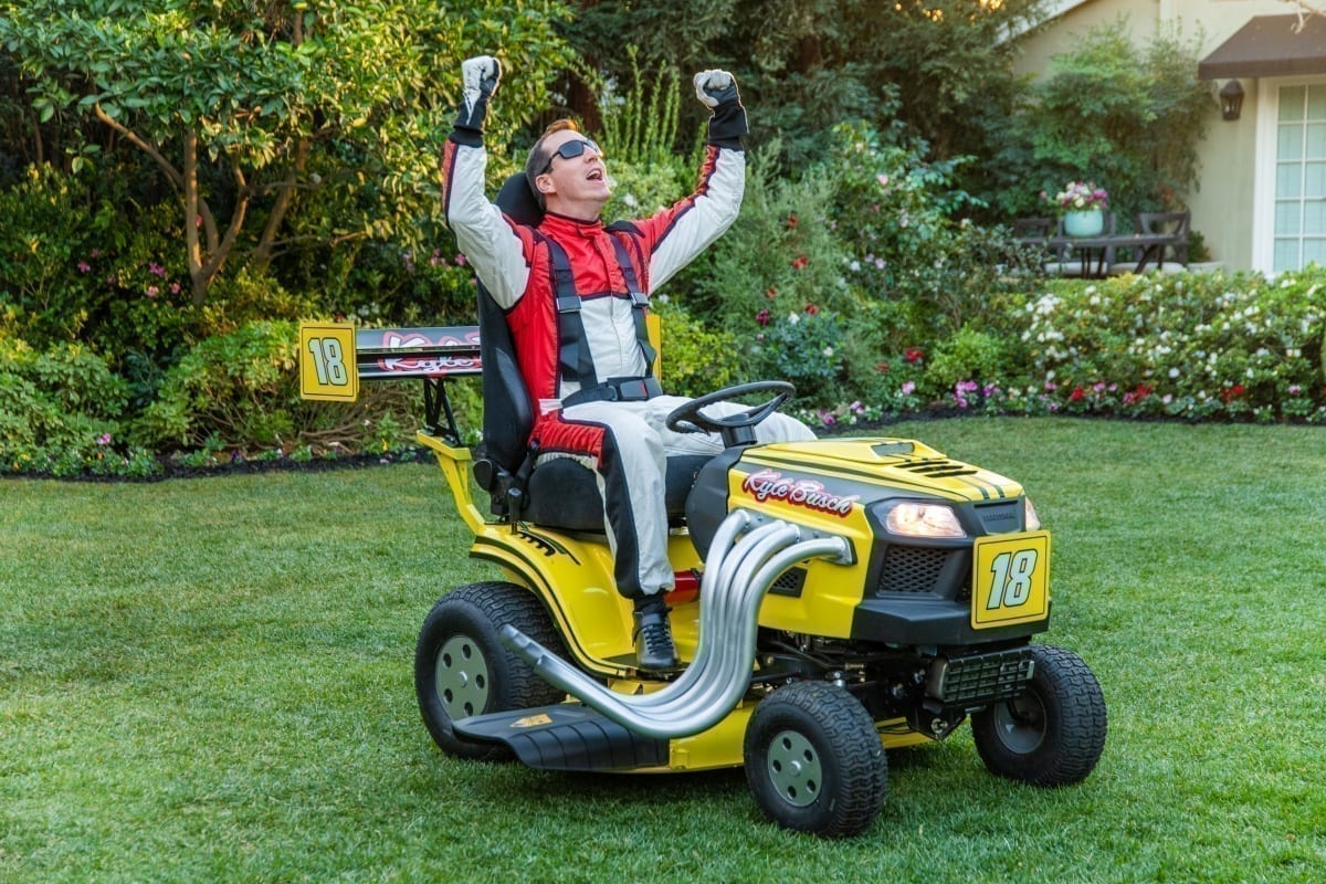 Kyle Busch trades a race car for a ride-on mower in the ScottsMiracle-Gro Super Bowl ad.